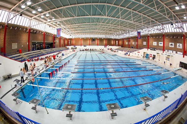 Mansion with indoor pool with diving board  The Official Website of UIC Flames Athletics